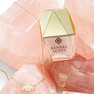 Kendra Scott Rose Quartz Nail Polish and Elisa Pendant Necklace on Natural Rose Quartz Stone