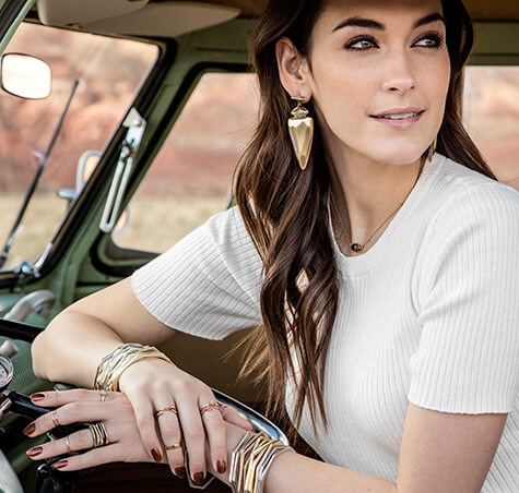 Kendra Scott Fall 2016 statement earrings and bangle bracelets on girl in car